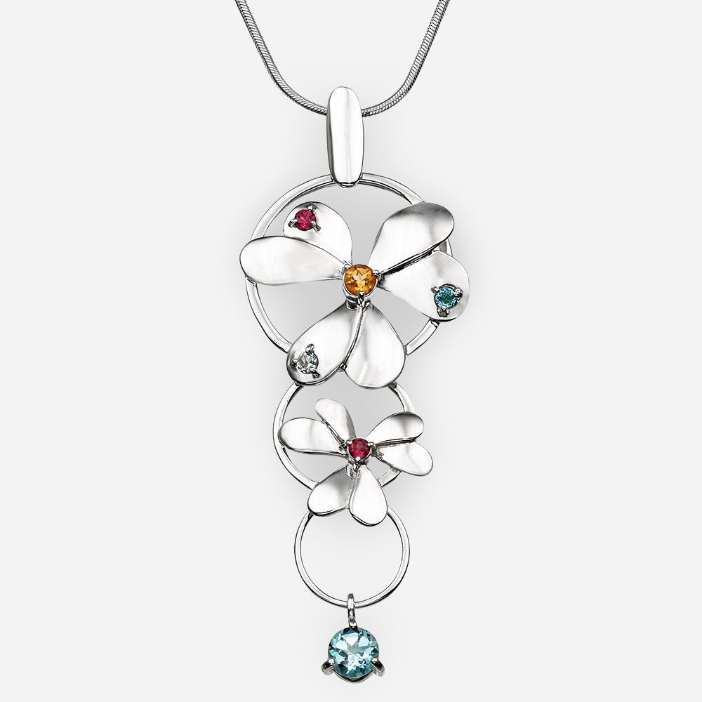 Long sterling silver flower pendant with citrine, garnet, and blue topaz gemstones.