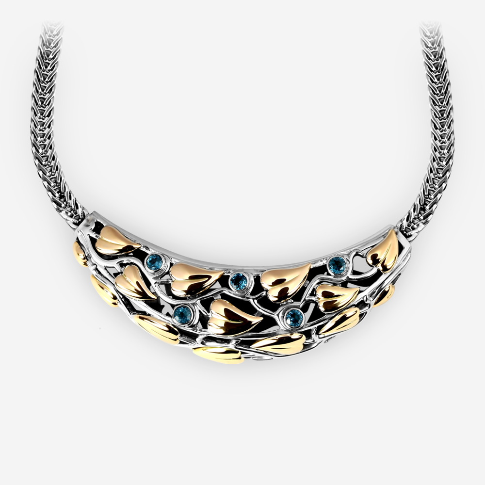 Ornate Two Tone Silver Statement Necklace made from sterling silver, 14k gold, and blue topaz gems.