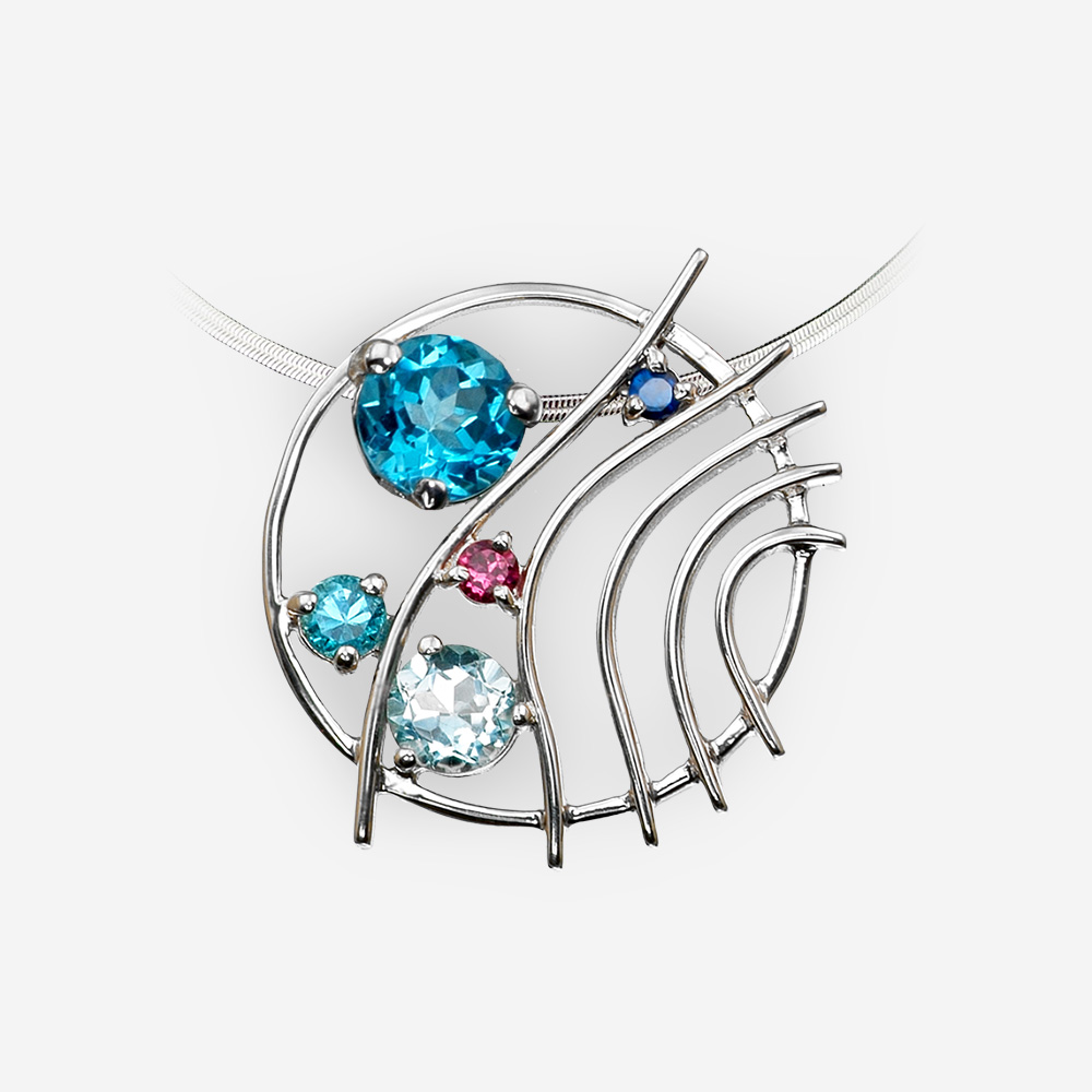 Round multi-gemstone silver pendant crafted from 925 sterling silver and is set with blue topaz and garnet.