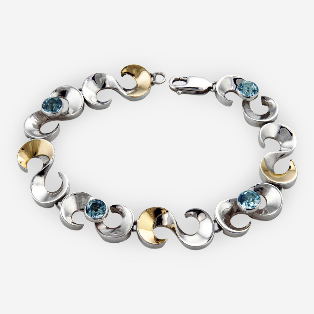 Scrolling silver link bracelet crafted from 925 sterling silver, 14k gold and faceted gemstones.