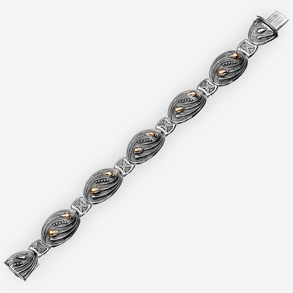 Pulsera de plata en forma de espiguilla con oro de 14k.