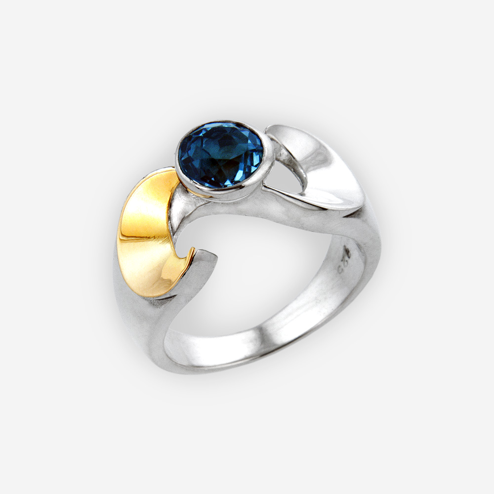 Silver S shaped ring crafted from 925 sterling silver and 14k gold and set with a gemstone.