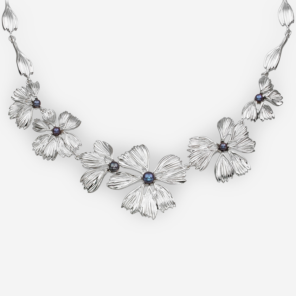 Silver statement necklace crafted from 925 sterling silver and set with black freshwater pearls.