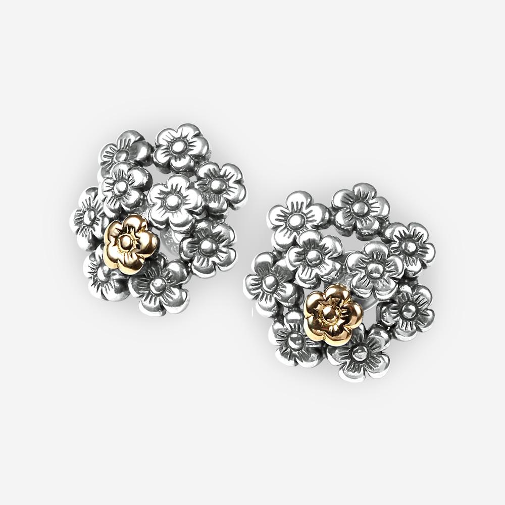 Aretes de tendencia floral de plata fina con una pequeña flor de oro de 14k y cierre con paloma y poste.
