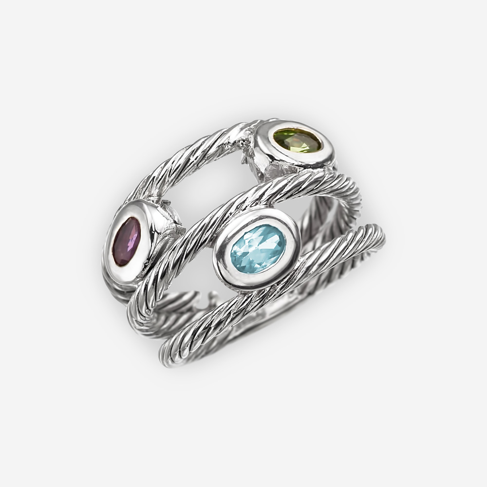Anillo de plata trenzado de cable con bandas de triple capa y amatista ovalada, topacio azul y gemas peridoto.